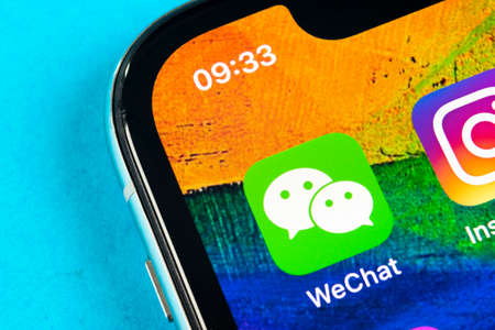 Helsinki, Finland, May 4, 2019: Wechat messenger application icon on Apple iPhone X smartphone screen close-up. Wechat messenger app icon. Social media network.