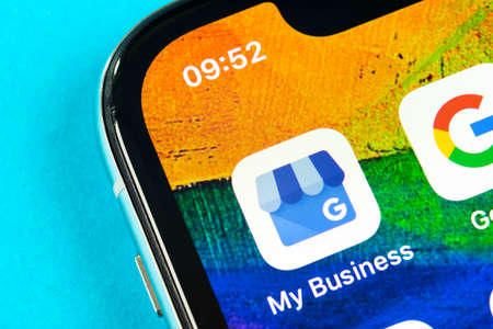 Helsinki, Finland, May 4, 2019: Google My Business application icon on Apple iPhone X screen close-up. Google My Business icon. Google My business application. Social media network 報道画像