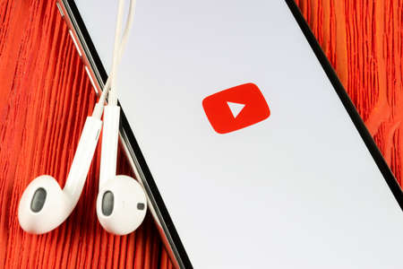 Helsinki, Finland, May 4, 2019: YouTube application icon on Apple iPhone X smartphone screen close-up. Youtube app icon. Social media icon. Social network