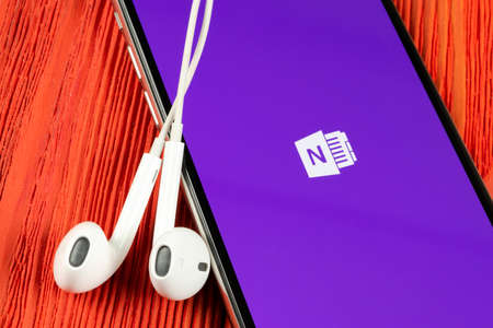 Helsinki, Finland, May 4, 2019: Microsoft OneNote office application icon on Apple iPhone X screen close-up. Microsoft One Note app icon. Microsoft OneNote application. Social media network
