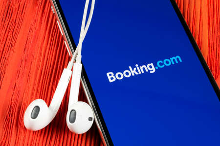 Helsinki, Finland, May 4, 2019: Booking.com application icon on Apple iPhone X screen close-up. Booking app icon. Booking.com. Social media app. Social network 報道画像