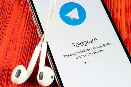 Helsinki, Finland, May 4, 2019: Telegram application icon on Apple iPhone X screen close-up. Telegram app icon. Telegram is an online social media network. Social media app