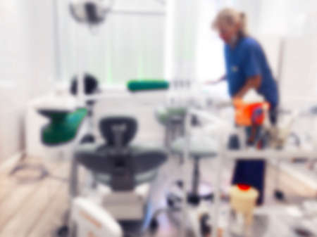 Dentist office background , dental hygiene, dentists chair. Blurred view of dentists office interior with chair and equipment. Professional dentists equipment and blurred doctor with patient Imagens