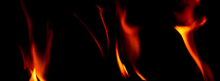 Fire texture isolated on black background. Fire flames on black background. Fire patterns. Texture of flames throughout the space. Red flames up close. The background with flames of fire.