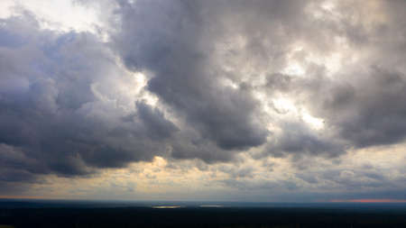 Aerial image of dark Storm clouds over the land. Aerial panorama of storm clouds. Panorama of thunder clouds. View from drone. Aerial birds eye view. Aerial top view cloudscape. Texture of clouds.