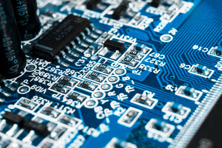 Macro shot of a Circuitboard with resistors microchips and electronic components. Computer hardware technology. Integrated communication processor. Information engineering. Semiconductor. PCB. Closeup Reklamní fotografie