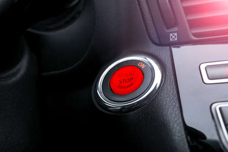 Car dashboard with focus on engine start stop button. Modern car interior details. startstop button. Car inside