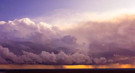 Aerial image of dark Storm clouds over the land. Aerial panorama of storm clouds. Panorama of thunder clouds. View from drone. Aerial bird's eye view. Aerial top view cloudscape. Texture of clouds. Standard-Bild