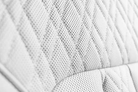 Modern luxury Car white leather interior. Part of perforated leather car seat details. White Perforated leather texture background. Texture, artificial leather with stitching. Perforated leather seats 版權商用圖片