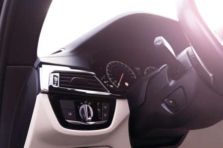Car interior with light switch. The light knob in the car. Multifunction headlight console control switch. Turn on-off headlight switch in the car.