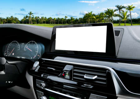 Monitor in car with isolated blank screen use for navigation maps and GPS. Isolated on white with clipping path. Car detailing. Car display with blank screen. Modern car interior details. Mock up