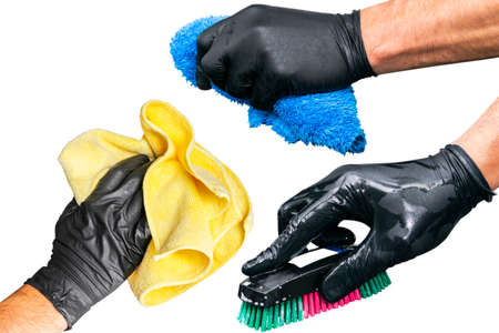 Washing concept. A male man hand with brush isolated on white background. Worker cleaning. Cleaning with the foam and a brush. Cleaning concept - hand in black protective rubber glove