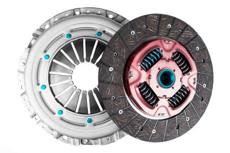 Car repair kit clutch manual gearbox isolated on a white background. Car and truck clutch disk. Composite clutch disc. Clutch repair kit. Car maintenance spare parts 版權商用圖片