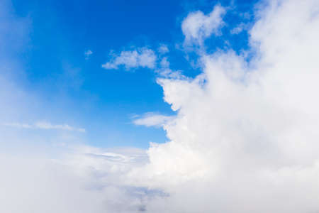 Aerial view white clouds in blue sky. View from drone. Aerial top view cloudscape. Texture of clouds. View from above. Sunrise or sunset over clouds. Panorama clouds