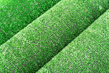 Artificial grass lawn texture. Artificial Turf Background. Greenering with an artificial grass. Rolled artificial turf laying background texture. Roll of an synthenic grass layer