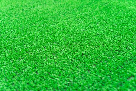 Artificial grass lawn texture. Artificial Turf Background. Greenering with an artificial grass. Artificial turf laying background texture. Synthenic grass layer