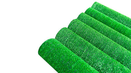 Artificial grass lawn texture isolated on white. Artificial Turf Background. Greenering with an artificial grass. Rolled artificial turf laying background texture. Roll of an synthenic grass layer