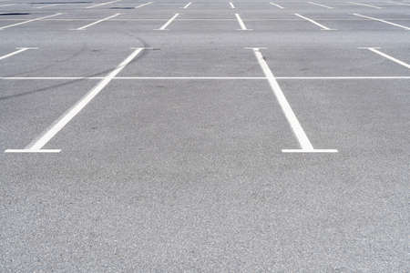 Empty car parking near shopping mall. Modern parking lot. Carpark. Empty parking spaces at the shopping center. Public carpark. Outdoor parking. Stock Photo