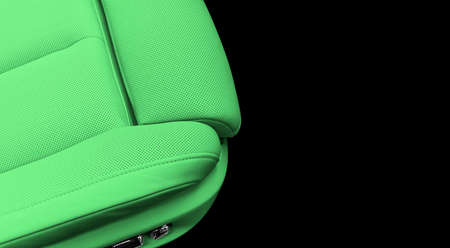 Green leather interior of the luxury modern car. Perforated green leather comfortable seats with stitching isolated on black background. Modern car interior details. Car detailing. Car inside