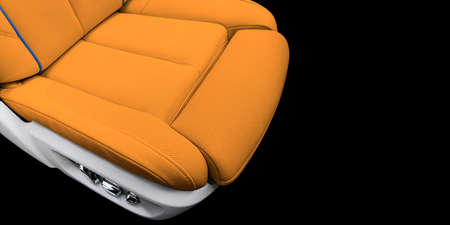 Orange leather interior of the luxury modern car. Perforated brown leather comfortable seats with stitching isolated on black background. Modern car interior details. Car detailing. Car inside