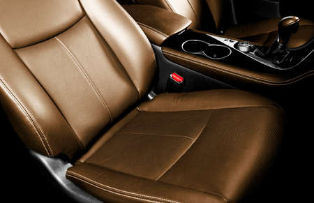Luxury car brown leather interior. Part of leather car seat details with stitching. Comfortable perforated orange leather seats. Brown perforated leather. Car insidel 版權商用圖片