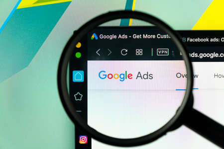 Sankt-Petersburg, Russia, June 16, 2020: Google Ads AdWords application icon on Apple iMac monitor screen under magnifying glass. Google Ad Words icon. Google ads Adwords application.