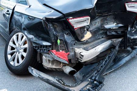 A black car crashed accident. Car accident on the road. Car crash accident on street. Damaged vehicle. Car insurance concept. Black color vehicler get big damage by accident on the road.