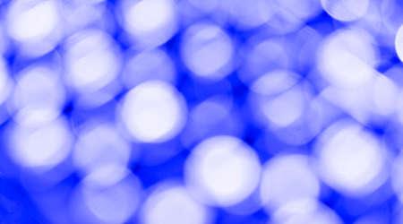 Blue bokeh light backgrounds. Blurred defocused dots. Abstract blurred reflection lighting. Bokeh with festive light background. Banco de Imagens