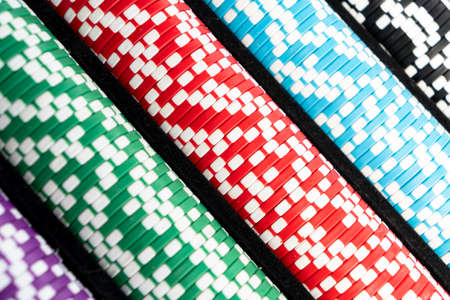 Stack of poker chips isolated background. Poker game concept. Playing a game with dice. Casino Concept for business risk chance good luck. Chips for poker game Banco de Imagens