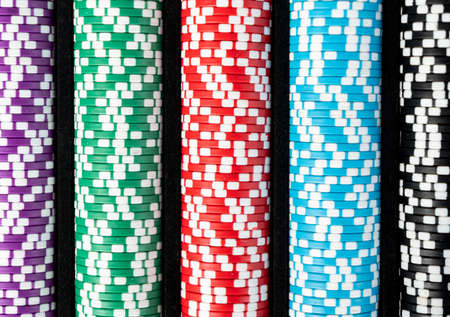 Stack of poker chips isolated background. Poker game concept. Playing a game with dice. Casino Concept for business risk chance good luck. Chips for poker game Stock Photo