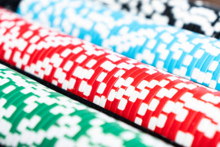 Stack of poker chips isolated background. Poker game concept. Playing a game with dice. Casino Concept for business risk chance good luck. Chips for poker game 免版税图像