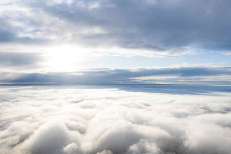 Aerial view white clouds in blue sky. View from drone. Aerial view cloudscape texture background. Texture of clouds. View from above. Panorama clouds background 免版税图像