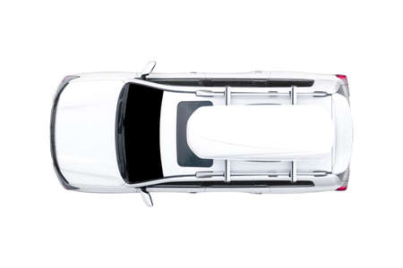 Modern white SUV car isolated on white background. Top view of white car isolated over white background. Aerial view isolated car with travel box 免版税图像