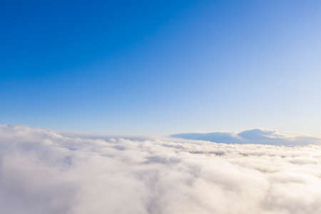 Aerial view white clouds in blue sky. Aerial top view cloudscape. Texture of clouds. View from above. Clouds texture background. Panorama clouds texture