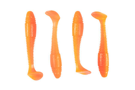 Jig silicone fishing lures isolated on a white background. Silicone fishing baits isolated. Colorful baits. Fishing spinning bait. Silicone soft plastic bait lure