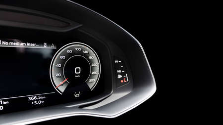 Close up shot of a digital speedometer in car. Fully digital car dashboard. Dashboard details with indication lamps. Car instrument panel.