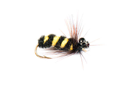 Macro shot colorful fishing fly isolated on a white background. Hand made fly fishing flies. Fluffy fly fishing hook isolated.