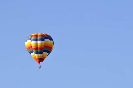 Hot air balloon in the blue sky photo