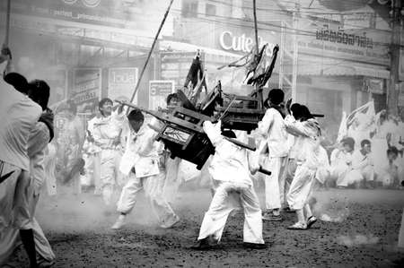 lunar month: Unidentified people of parade on vegetarian festival in Trang, Thailand  The Vegetarian Festival is an annual festival held during the ninth lunar month of the Chinese calendar  TRANG, THAILAND - OCT 12, black and white Color