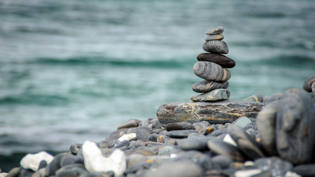 Stones stacked on HIN NGAM Island, TARUTAO National Park, Thailand  - Stock Image