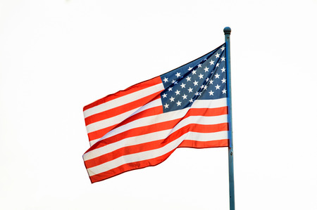American flag waving on flagpole, isolated white background