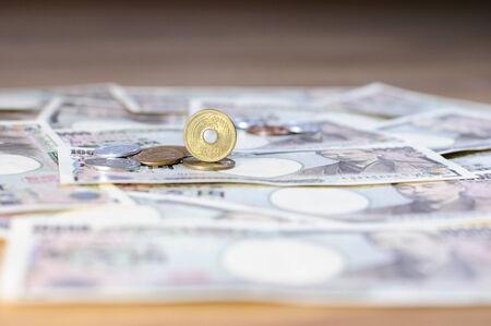 yen note: Japanese yen coin and Yen Bank Note, money background