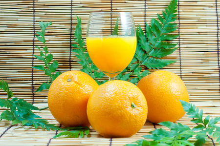 Orange and juice with leafs photo