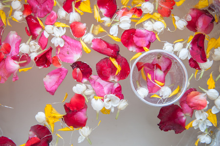 Water with jasmine and roses corolla in bowl for Songkran festival in Thailand  Stock Photo