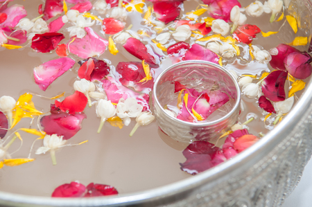 corolla: Water with jasmine and roses corolla in bowl for Songkran festival in Thailand  Stock Photo
