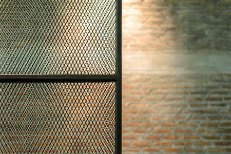 Metal door see brick wall  photo