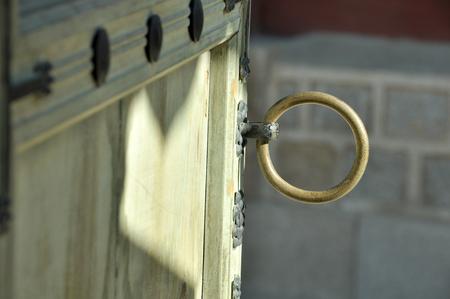 doorhandle: Old wooden door with circle ancient door-handle in Korea Stock Photo