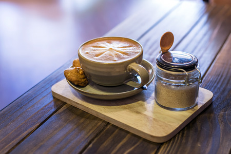 Coffee in cup and cookies in coffee cafe photo
