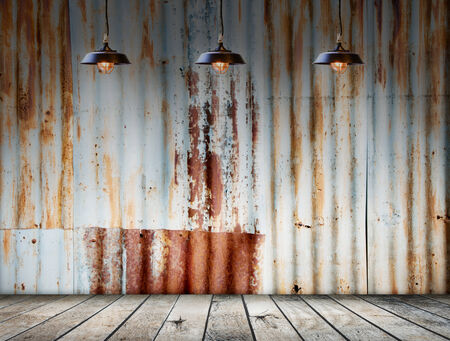 Lamp at Rusted galvanized iron plate with wood floor photo