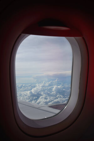 airplane window: Clouds and sky from window plane